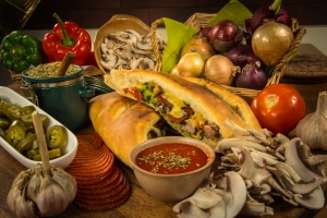 Like pizza, calzone lends itself to all sorts of meats and vegetables. - tangledpasta.net